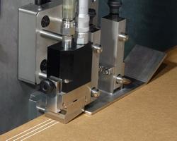 WM 801 liquid adhesive applicators for high-speed intermittent applications.