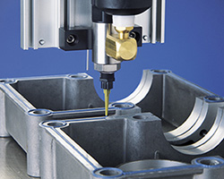 Nordson EFD's sealant dispensing equipment applying a consistent, continuous bead of sealant onto an automotive part.