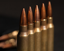 High precision fluid dispensing systems for ammunition sealing.