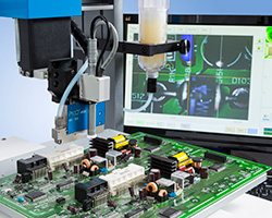 Nordson EFD robot dispensing onto a printed circuit board