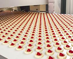 Jam tarts on a conveyor belt