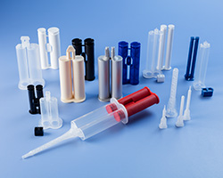 Disposable DIY (do-it-yourself) dual syringes and static mixers for controlled mixing and placement of two-component epoxies, adhesives, sealants, gels, pastes and compounds used in home improvement and dental applications.