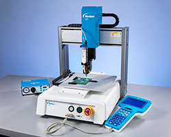 The 3-axis E Series automated fluid dispensing robot features a Teach Pendant for easy programming of industrial applications. This tabletop or desktop robot also easily integrates into different types of assembly lines.